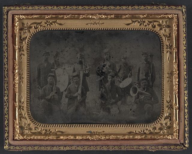 Ten unidentified soldiers that form a Union regimental band with saxhorns and drums (between 1861 and 1865; LOC: LC-DIG-ppmsca-32063)