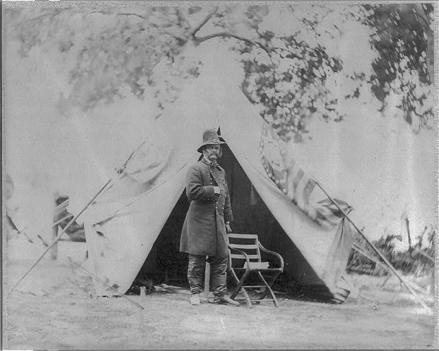 Ambrose Everett Burnside, 1824-1881, Major General, full-length portrait, standing in front of tent, arm bent with hand in coat, facing right (no date recorded on caption card; LOC: LC-USZ62-50365)