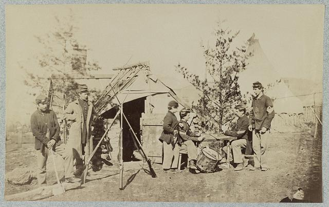 [Drummer boys off duty, playing cards in camp, winter of 1862] (1862, printed later]; LOC: LC-DIG-ppmsc-02787)