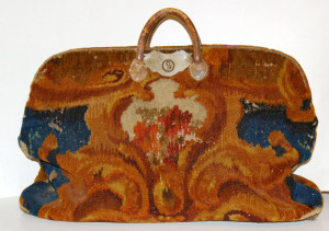 Carpetbag (American carpetbag circa 1860; wool with leather handles.)