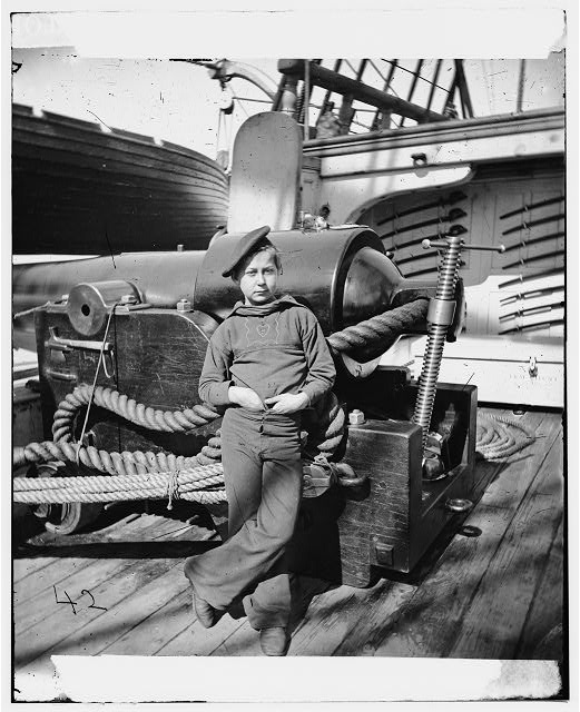 [Powder monkey by gun of U.S.S. New Hampshire off Charleston, S.C.] (Between 1864 and 1865; LOC: LC-DIG-cwpb-03515)