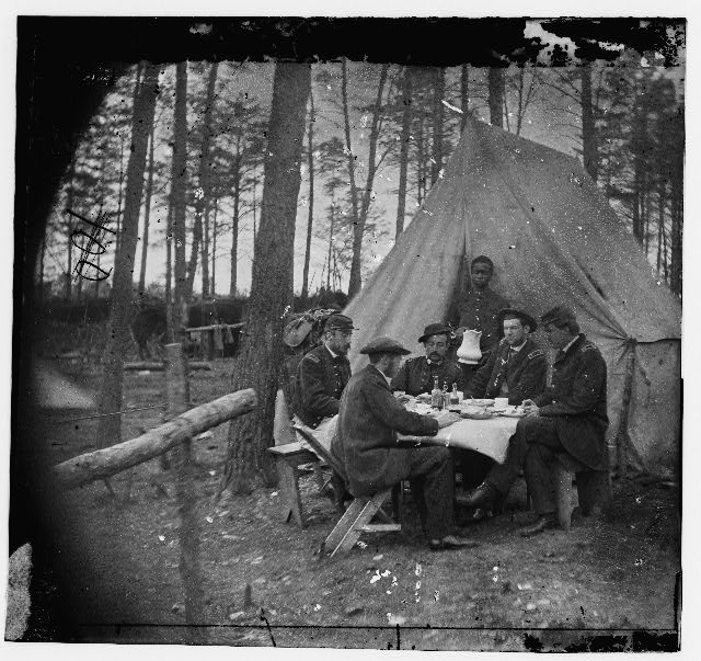 [Brandy Station, Va. Dinner party outside tent, Army of the Potomac headquarters] (by Timothy H. O'Sullivan, 1864 April; LOC: LC-DIG-cwpb-00725)