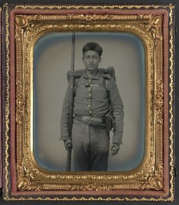 Unidentified soldier in Ohio Volunteer Militia uniform with bedroll and musket (between 1861 and 1865; LOC: LC-DIG-ppmsca-37409)