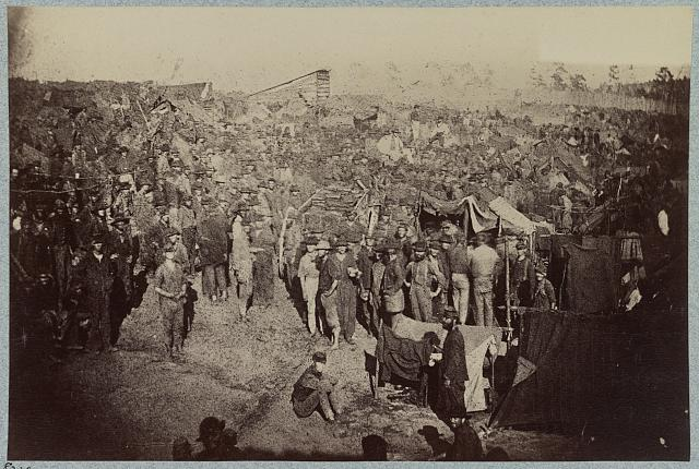 Andersonville Prison, Ga., August 17, 1864. Issuing rations, view from main gate (LOC:  LC-DIG-ppmsca-34562)