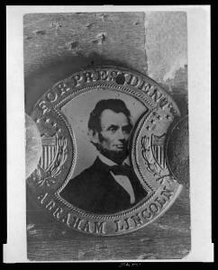 "Photograph of a campaign button with portrait of Abraham Lincoln and inscription ""For President Abraham Lincoln"" (1864, printed later; LOC:  LC-USZ62-126415)"
