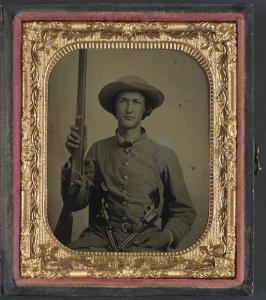 Unidentified soldier in Confederate infantry uniform with model 1842 musket and two Colt revolvers (between 1861 and 1865; LOC: LC-DIG-ppmsca-32591)