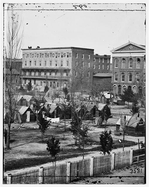Atlanta, Ga. Trout House, Masonic Hall, and Federal encampment on Decatur Street (by george N. Barnard, 1864; LOC: LC-DIG-cwpb-03304)