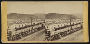 Home views. No. 15, Rebel prison - 1865 (Elmira, N.Y. : Published by J.E. Larkin, 118 Water Street, [between 1865 and 1880]; LOC: LC-DIG-stereo-1s02989)
