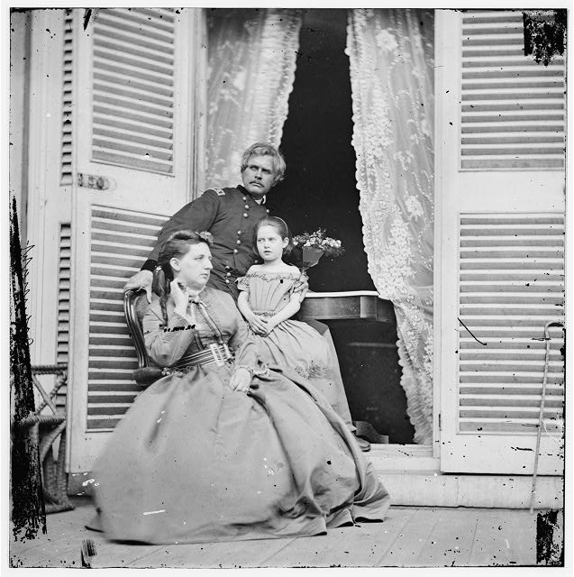 Richmond, Virginia. Gen. Edward O.C. Ord, wife and child at the residence of Jefferson Davis. In the doorway is the table on which the surrender of Gen. Robert E. Lee was signed (April 1865; LOC: LC-DIG-cwpb-02928)