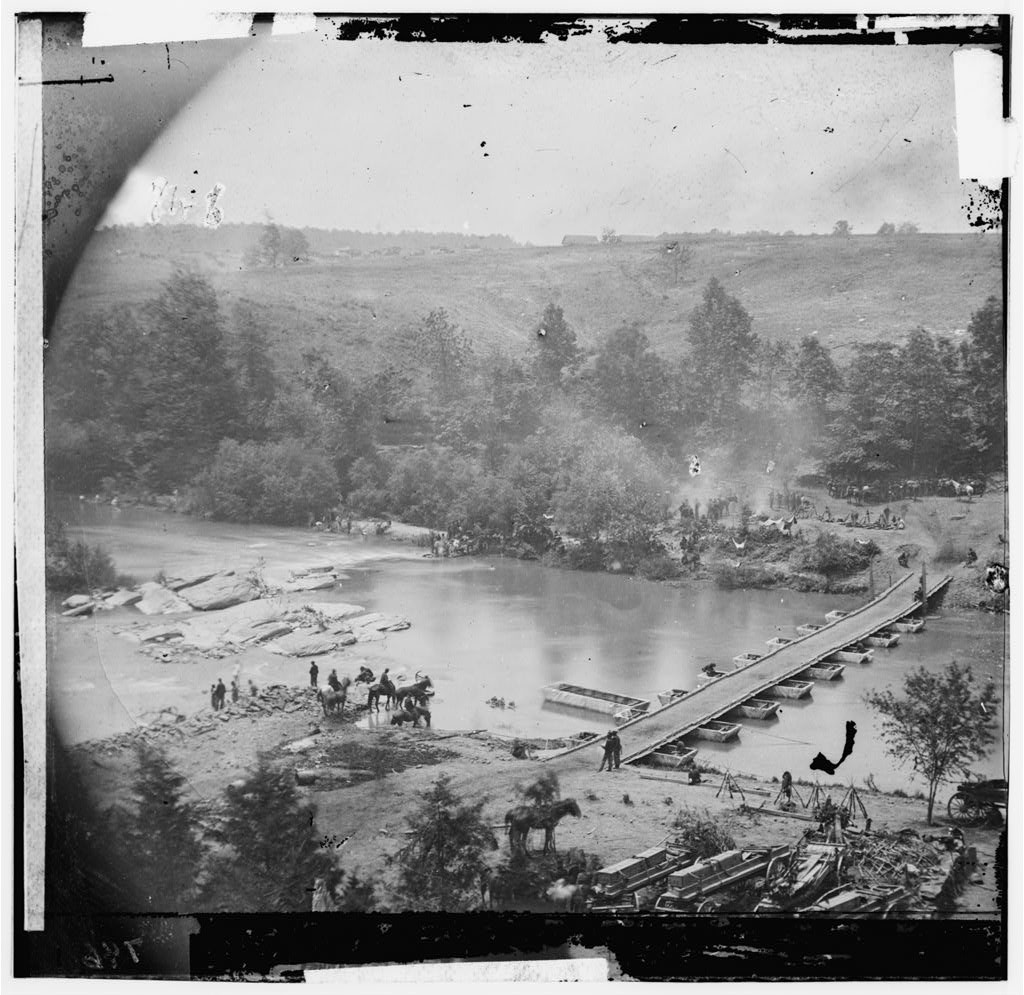 Jericho Mills, Va. Canvas pontoon bridge across the North Anna, constructed by the 50th New York Engineers; the 5th Corps under Gen. Gouverneur K. Warren crossed here on the 23d. View from the north bank (by Timothy H. O'Sullivan; 1864; LOC: http://www.loc.gov/item/cwp2003000481/PP/)