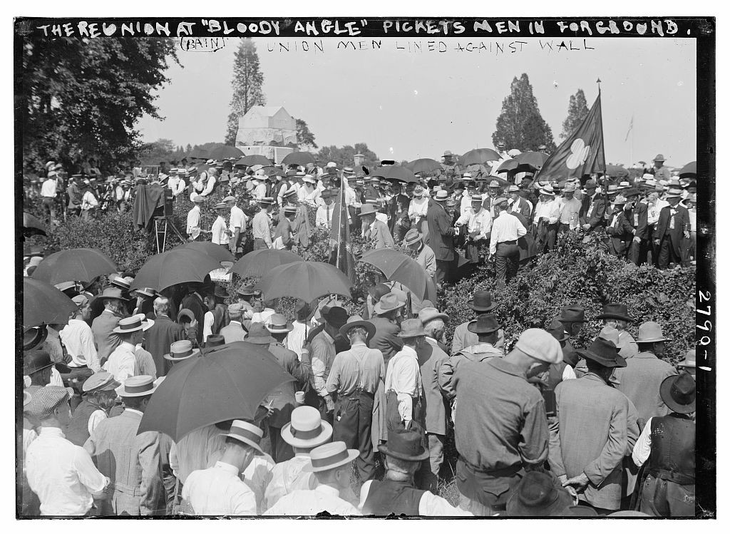 "The reunion at ""Bloody Angle"" - Pickett's men in for[e]ground; Union men lined against wall  (1913; LOC: http://www.loc.gov/item/ggb2005013846/)"