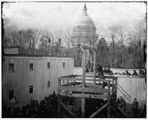 Washington, D.C. Soldier springing the trap; men in trees and Capitol dome beyond (by Alexander Gardner; LOC: http://www.loc.gov/item/cwp2003001033/PP/)