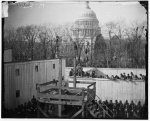 Washington, D.C. Hooded body of Captain Wirz hanging from the scaffold (by Alexander Gardner; LOC: http://www.loc.gov/item/cwp2003001034/PP/)