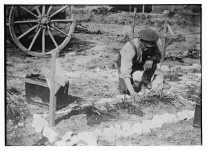 Decorating a grave (1917 May 3; LOC: http://www.loc.gov/item/ggb2006000167/)