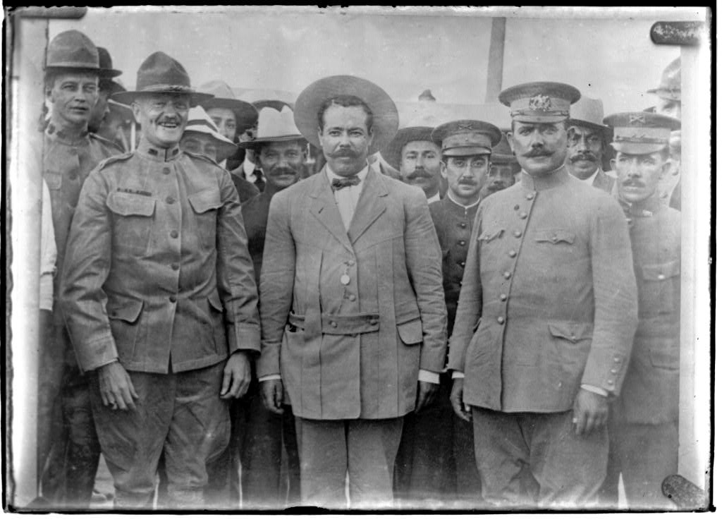 Generals Obregon, Villa and Pershing meet at Ft Bliss, TX (1). Immediately behind Pershing on the left is his aide Lt. George S. Patton. (https://memory.loc.gov/ammem/today/jul15.html)