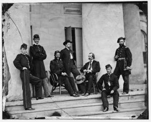 [Arlington, Va. Brig. Gen. Gustavus A. DeRussey (third from left) and staff on portico of Arlington House] (1864 May.; LOC: https://www.loc.gov/item/cwp2003000933/PP/#)