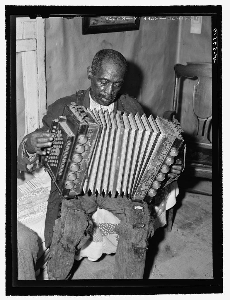 John Dyson, FSA (Farm Security Administration) borrower, playing the accordion. He was born into slavery over eighty years ago. Saint Mary's County, Maryland (1940 Sept.; LOC: https://www.loc.gov/item/fsa2000041990/PP/)