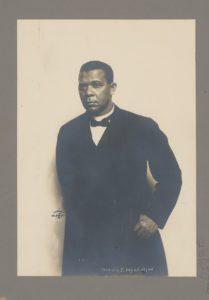 Booker T. Washington, half-length portrait, standing, against white background (LOC: https://www.loc.gov/item/98502189/)