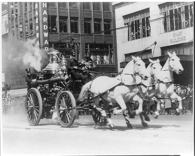 Horse-drawn fire engine rushing to a fire ([between ca. 1900 and ca. 192; LOC: https://www.loc.gov/item/2012646404/))