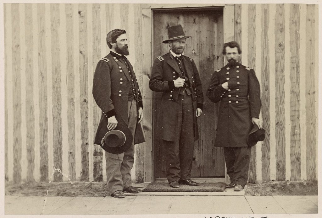 Gen. John A. Rawlins, left, Gen. U.S. Grant, center, and an unidentified officer (photographed between 1861 and 1865, printed later; LOC: https://www.loc.gov/resource/ppmsca.34091/)